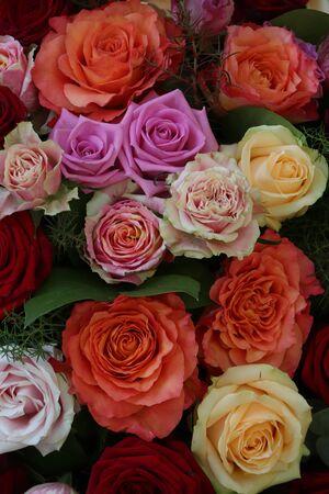 Wedding flower arrangement, big roses in bright colors