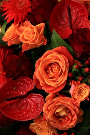 Mixed flower arrangement: various flowers in different shades of orange and red for a wedding Stock Photo