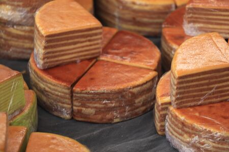 Fresh baked spekkoek, a traditional Indonesian layer cake, made of egg yolks, butter and sugar Stock Photo
