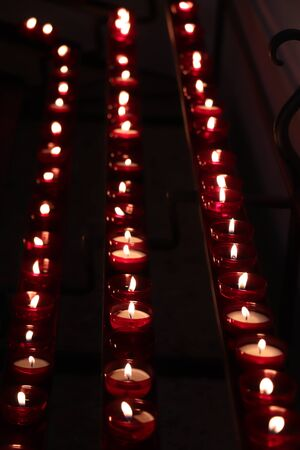 Red Votive candles, burning in a dutch protestant Christian church