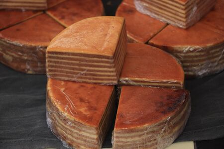 Fresh baked spekkoek, a traditional Indonesian layer cake, made of egg yolks, butter and sugar Stock Photo - 133095994