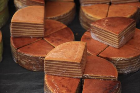 Fresh baked spekkoek, a traditional Indonesian layer cake, made of egg yolks, butter and sugar Stock Photo - 133096342
