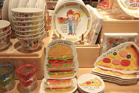Assen, the Netherlands, July 27th 2019: Blond Amsterdam crockery on display in a shop. Blond Amsterdam is a Dutch lifestyle brand, known for colorful cartoon drawings Stockfoto