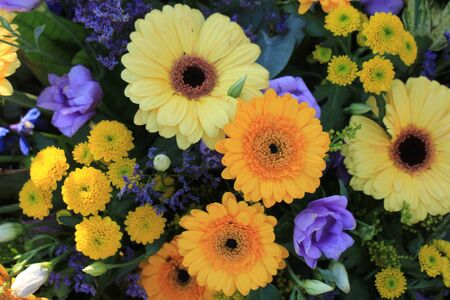 flower arrangement for a wedding in yellow, blue and orange