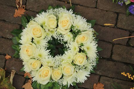 Sympathy wreath made of various white flowers Stockfoto
