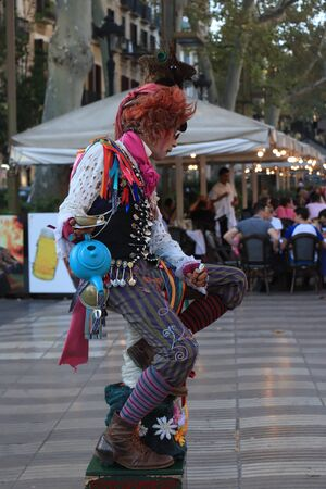 Barcelona, Spain - september 29th 2019: Colorful street artist, performing the Mad Hatter from Alice in Wonderland on famous Ramblas in Barcelona Redakční
