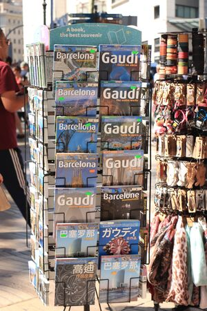 Barcelona, Spain - september 30th, 2019: Books about the famous Spanish architect Gaudi in a book stall on the Ramblas, Barcelona. Gaudi was th architect of the Sagrada familia, Parc Guell and other famous buildings Redakční