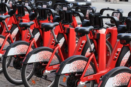Barcelona, Spain - september 28th, 2019: Red rental bicycles, parked in the city centre of Barcelona, Spain. Environmentally sustainable transport. Redakční
