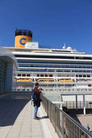 Barcelona, Spain - September, 24th 2019: Passenger waiting to board the Costa Magica, moored at the Barcelona cruise terminal