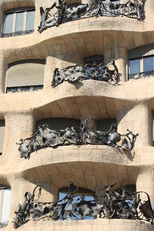 Barcelona, Spain - september 29th, 2019: The Casa Mila,  known as La Pedrera, modernist building designed by architect Antoni Gaudi, built between 1906 and 1910. Detail of Balcony Redakční