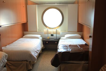 Amsterdam, the Netherlands - August 2nd 2014: Costa NeoRomantica, standard inside cruise ship cabin with window Editoriali