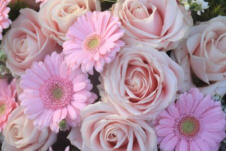 Pale pink roses and gerberas in a floral wedding arrangement
