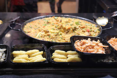 Fresh made paella, spanish cuisine with seafood and meat