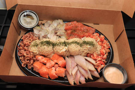 Serving plate with fresh luxurious seafood and sauce in take away carton box Stock fotó