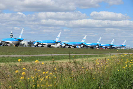 Amsterdam Airport Schiphol, The Netherlands - May 5th 2020: Airport in lockdown. Several KLM Boeing 777 planes parked at the Aalsmeer runway