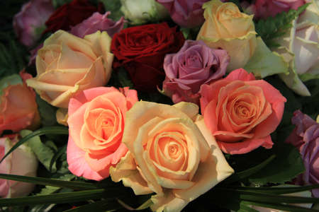 Pastel colored roses in a wedding flower arrangement