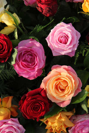 Multicolored roses in a flower arrangement