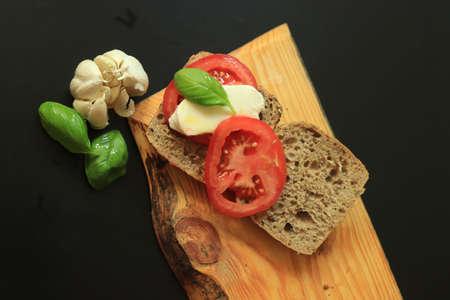 Italian Caprese sandwiches with fresh tomatoes, mozzarella cheese and basil Standard-Bild