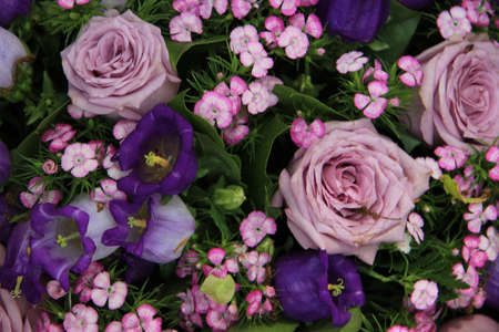 Purple and lilac flowers in a wedding bouquet Standard-Bild