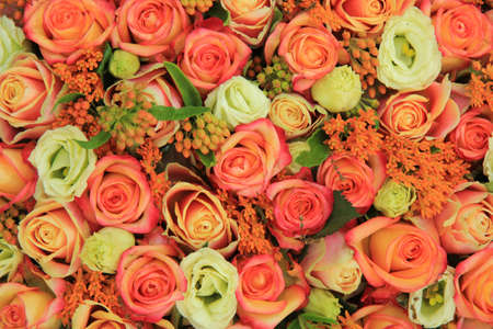 Orange and yellow roses in a bright bridal bouquet Standard-Bild