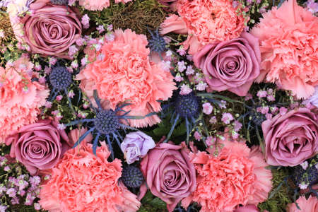 Pink Carnations and roses in a floral wedding decoration
