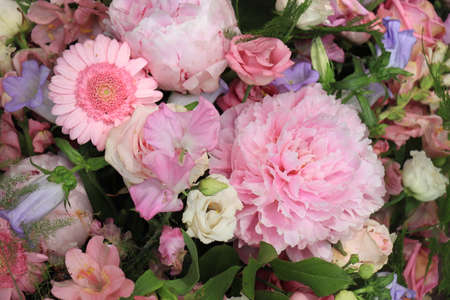 Mixed flower arrangement: various flowers in different shades of pink and purple for a wedding