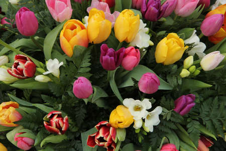 Mixed spring bouquet with tulips in various bright colors