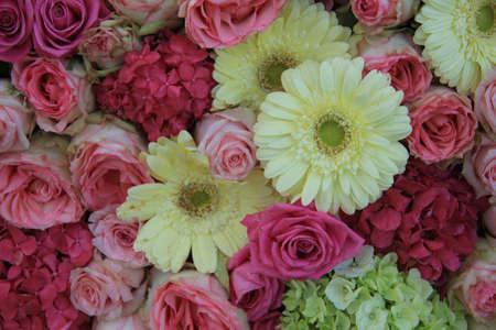 Yellow and pink wedding flower arrangement