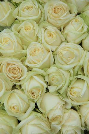 Classic white wedding arrangement with big white roses