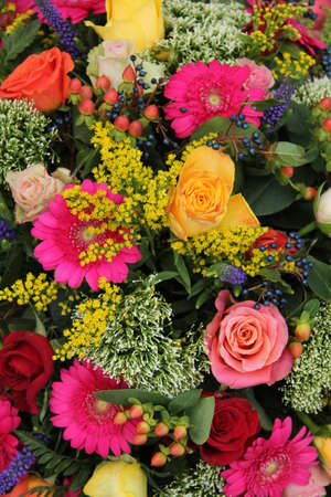 Various flowers in a mixed, bright colored arrangement Standard-Bild