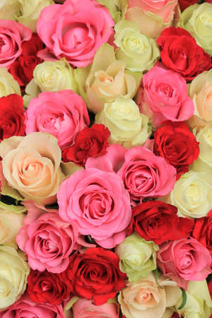 Big pink mixed roses in a floral wedding decoration