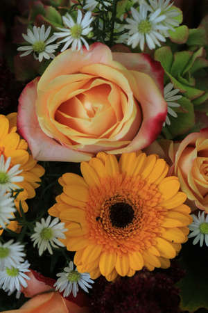 Yellow and white wedding flowers: yellow gerber and roses and white aster