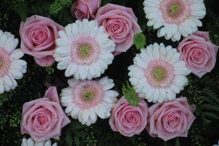 Gerberas and roses in a wedding flower arrangement