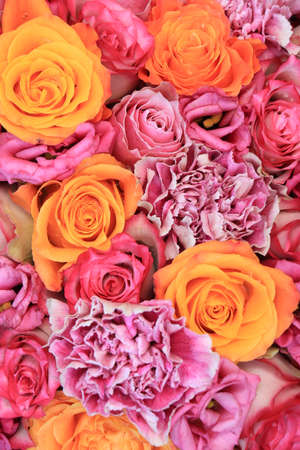 Wedding flowers: roses, carnations and listiant house in various shades of pink and orange