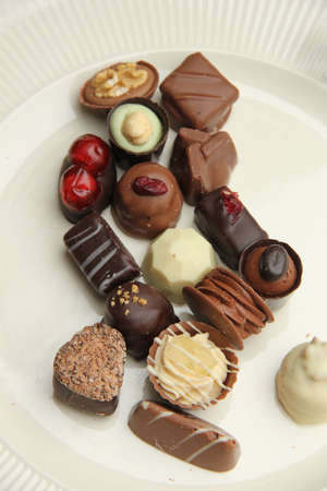 Delicious chocolates from Belgium, decorated with nuts and fruits
