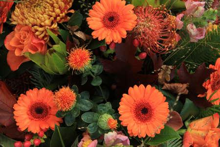 Autumn colored flower arrangement in orange and brown
