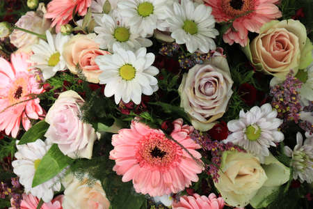 Mixed flower arrangement: various flowers in different shades of pink and white for a wedding