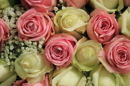 Pink and white roses in a floral wedding decoration