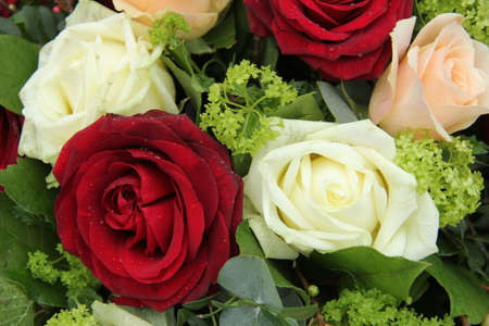 Bridal flower arrangement in red, pink and white, big roses