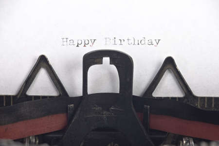 your text: Vintage typewriter with happy birthday written and room for your text Stock Photo