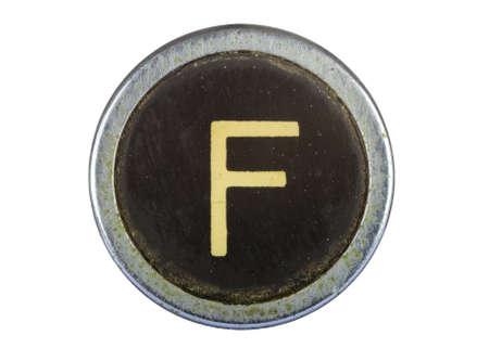 Vintage typewriter letter F isolated on white photo