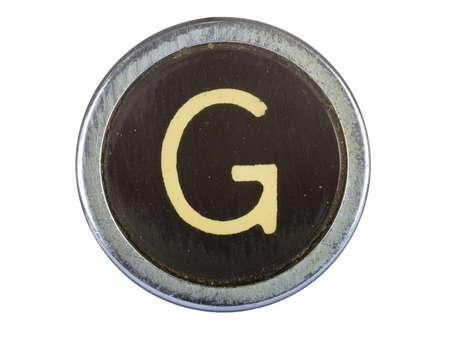 Vintage typewriter letter G isolated on white Stock Photo - 10567117