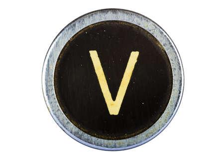 Vintage typewriter letter V isolated on white photo