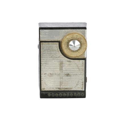 transistor: 1960 s era transistor radio isolated on a white background