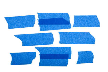 strips of blue masking tape isolated on white background
