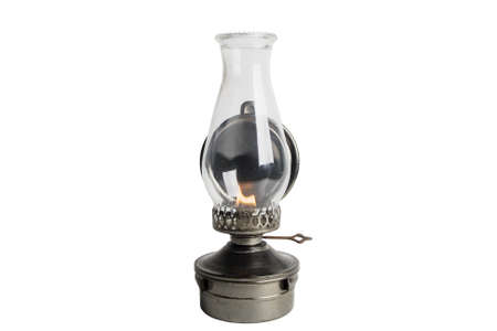 kerosene lamp: Lit Antique oil lamp isolated on white