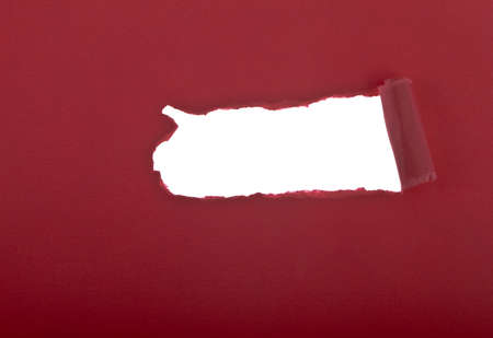 deterioration: Ripped red paper against a white background Stock Photo