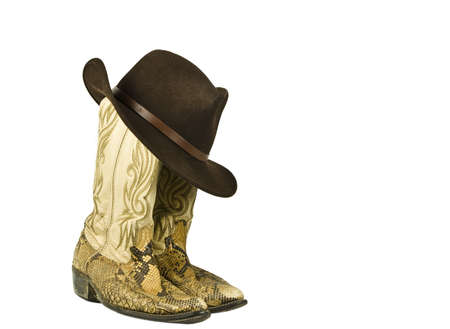 Snakeskin cowboy boots and hat isolated on white photo