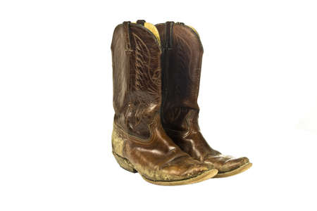 dirty feet: dirty cowboy boots Stock Photo