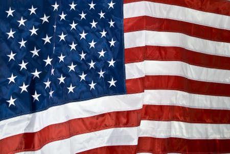 american flag waving: American Flag waving in the wind Stock Photo